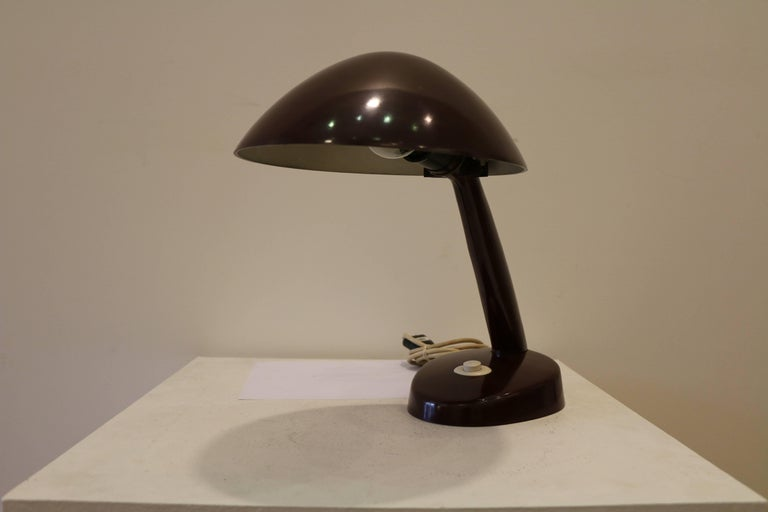 From 1924, lamp design became a field of interest at the Bauhaus, led by Brandt. Brandt was key in organizing the cooperation between the Bauhaus and Kandem, which encouraged the Bauhaus artists to take the step from manual production of unique
