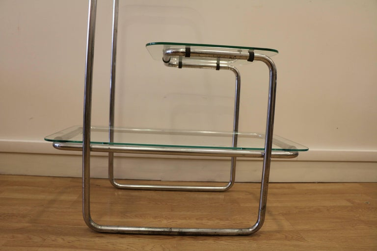 Shelves by Emile Guillot, circa 1930. These shelves have three levels with three glass panels on chromium tubular frame.
