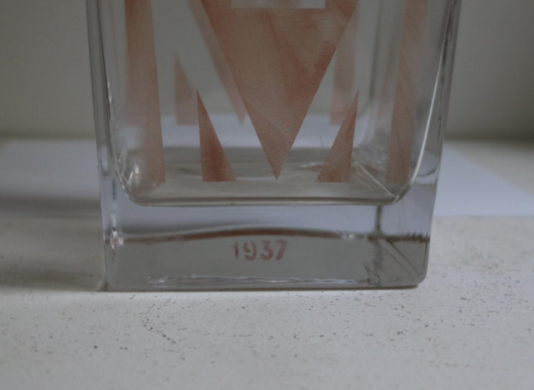 This cubist Art Deco vase was designed by A Riecke for the famous restaurant La Coupole in Paris. It is engraved with the date 1937. A Riecke was from Russian origin. He settled in Paris and was responsible for the Art Deco glass decor of restaurant