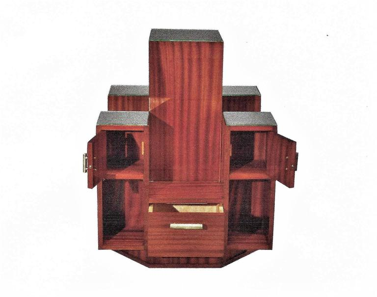 Very rare and spectacular display case by René Joubert (1878-1931) & Philippe Petit (1900-1945), edited by DIM (attributed). This piece of furniture is covered with mahogany venneer. It is symetrical on its four sides with a square shape constituted