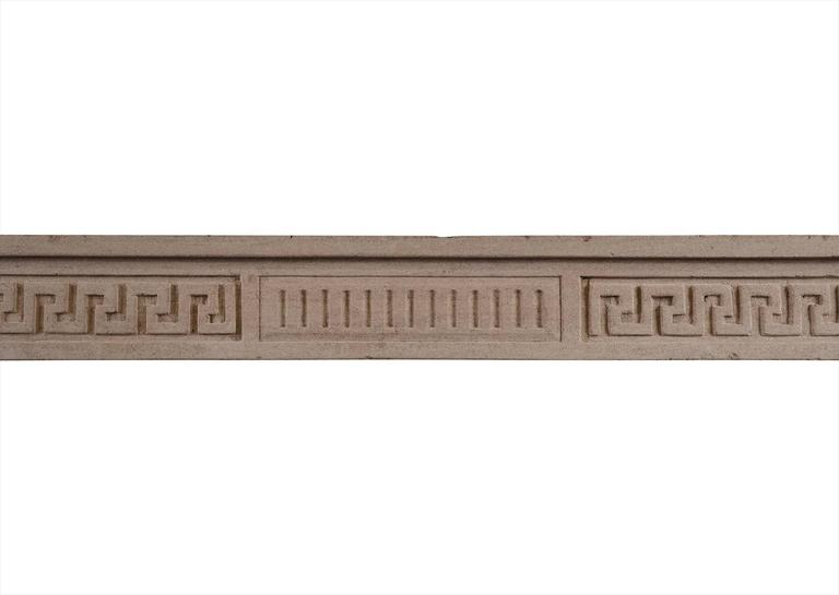An 18th century French Louis XVI limestone fireplace. The frieze with fluting to centre panel, flanked by Greek key pattern and carved rosettes. Stop-fluted jambs below. An attractive piece. Measures: Shelf width - 1508 mm, 59 ⅜ in. Overall