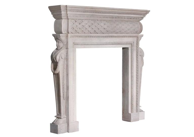 A 19th century English stone, Georgian style fireplace. The barrel frieze with carved laurel leaves and berries, supported by side facing caryatids with flowing garlands. The moulded jambs with acanthus mouldings, and the shelf with leaf and egg and