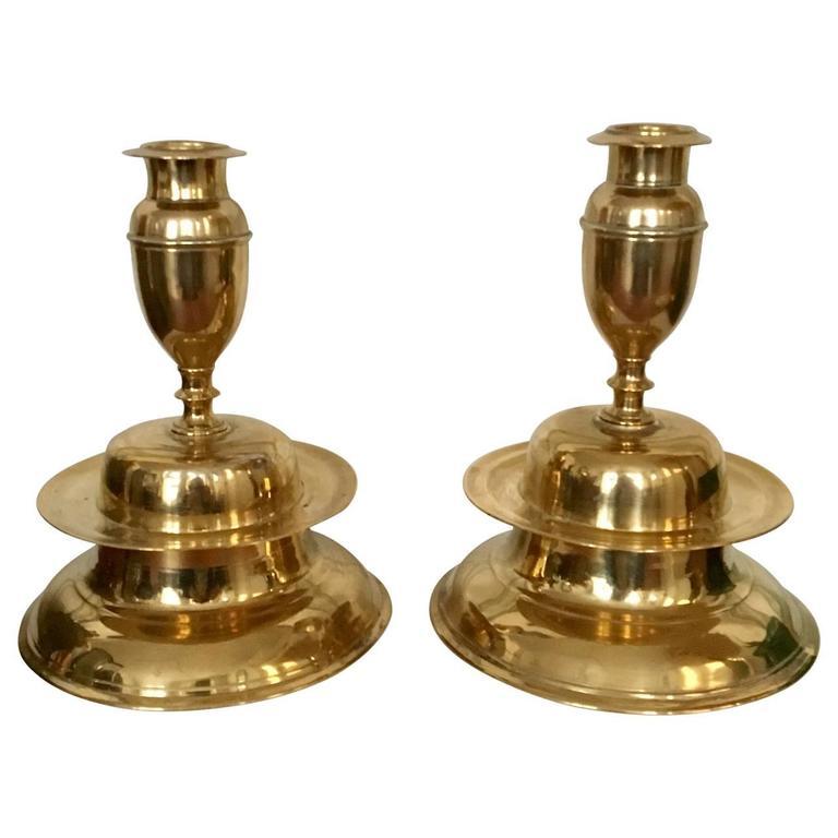 Beautiful pair of brass bell candleholders.
