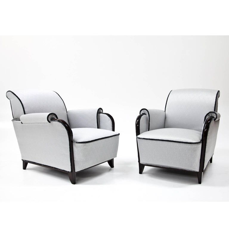 Pair of grey Art Deco lounge chairs on short tapered legs. The chairs are reupholstered with a high quality grey fabric and accentuated with black piping.