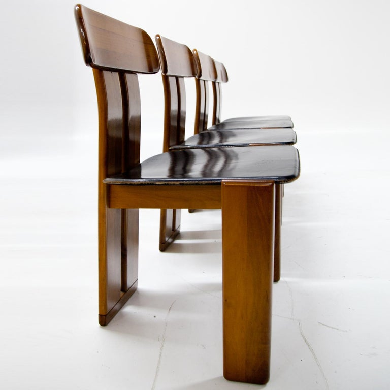 Four dining room chairs with black leather seats attributed to Afra & Tobia Scarpa for Maxalto.