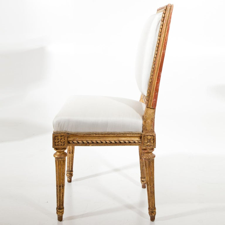 Gilt children's chair by Jean Baptiste Boulard (1725-1789) standing on fluted tapered legs, with a reupholstered backrest and seat in white. Stamped at the bottom JB Boulard.