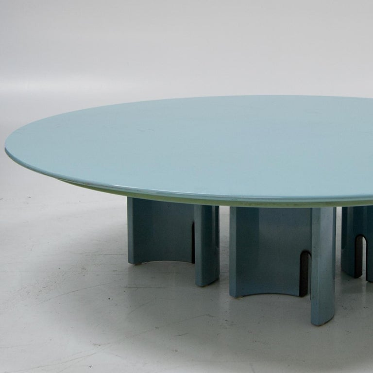 """Round coffee table in light blue designed by Giovanni Offredi for Saporiti. Labeled """"Saporiti Italia"""". Signs of age and use."""