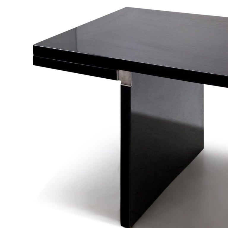 Long rectangular 'Orseolo' dining table, designed by Carlo Scarpa in 1972 for Gavina. The completely black table receives its unique and extravagant look through the unusual construction of the inner corners with metal angles. The table is labelled
