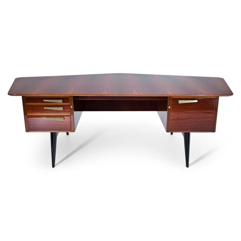 Scandinavian desk on black tapered legs, with four lockable drawers and a pentagonal large tabletop. The desk was designed for an all-round view. The desk is hand-polished and professionally refurbished. Label inside the second drawer.