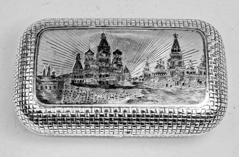 Gorgeous silver 875 cigarette box / case with etched and engraved picture covering lid: It shows the Kremlin in Moscow: The Moscow Kremlin, usually referred to as the Kremlin, is a fortified complex at the heart of Moscow, overlooking the Moskva