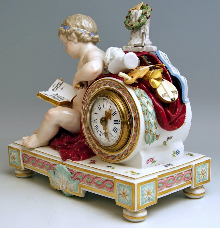 Meissen Gorgeous Mantel / Table Clock, abundantly decorated with Sculptured Figurine (= Cherub)  and  Symbols of Fine Arts.  Manufactory: Meissen Hallmarked:  Blue Meissen Sword Mark with Pommels on Hilts Model Number D 78 Former's Number 88 /