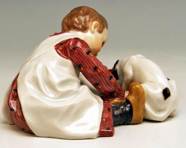 German Meissen Hentschel Child Boy Figurine with Drinking Dog Model W 123, circa 1905 For Sale