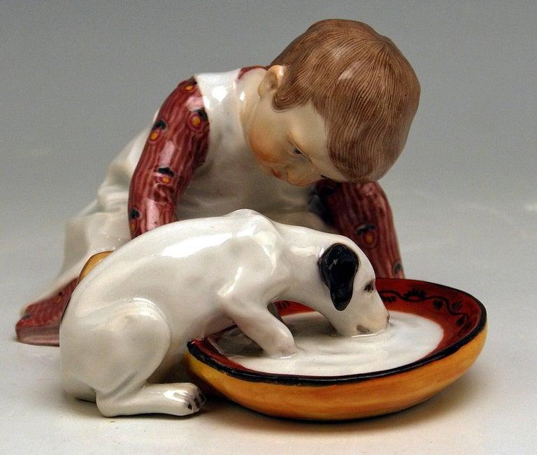 Painted Meissen Hentschel Child Boy Figurine with Drinking Dog Model W 123, circa 1905 For Sale