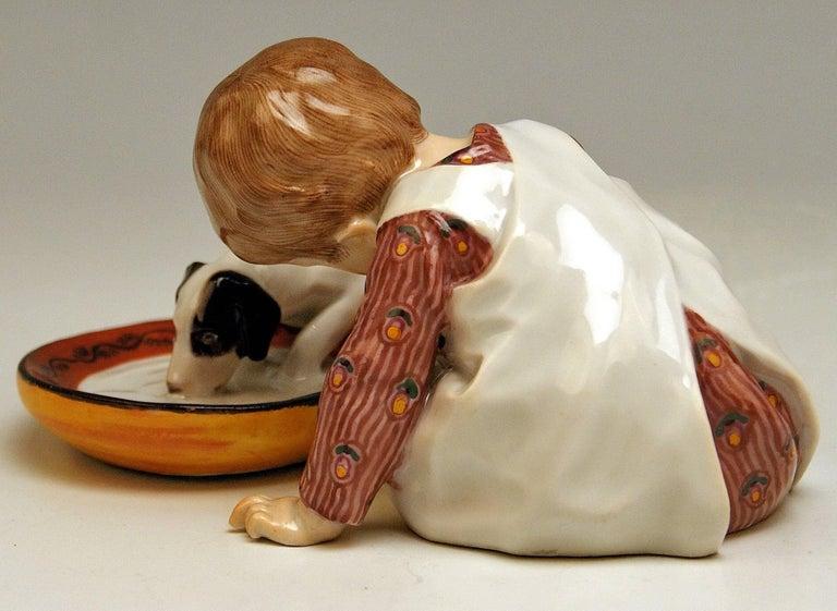Art Nouveau Meissen Hentschel Child Boy Figurine with Drinking Dog Model W 123, circa 1905 For Sale