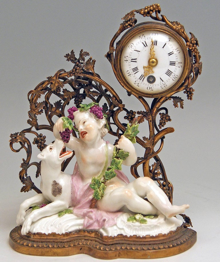 Meissen gorgeous rococo mantel / table clock made of gilded / gilt bronze, excellently decorated with sculptured figurines made of porcelain.  Manufactory: Meissen Hallmarked: Blue Meissen Sword Mark (bottom of figurines glazed) First