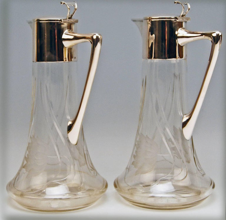 Excellent Pair of  Art Nouveau Glass Decanters  / Jugs,  made circa 1900  Manufactory: Alexander Birkl / Vienna  (= mark of manufactory impressed) Bibliography: Waltraud Neuwirth,  Viennese Gold - and Silversmiths and Their Marks 1867 - 1922 ,