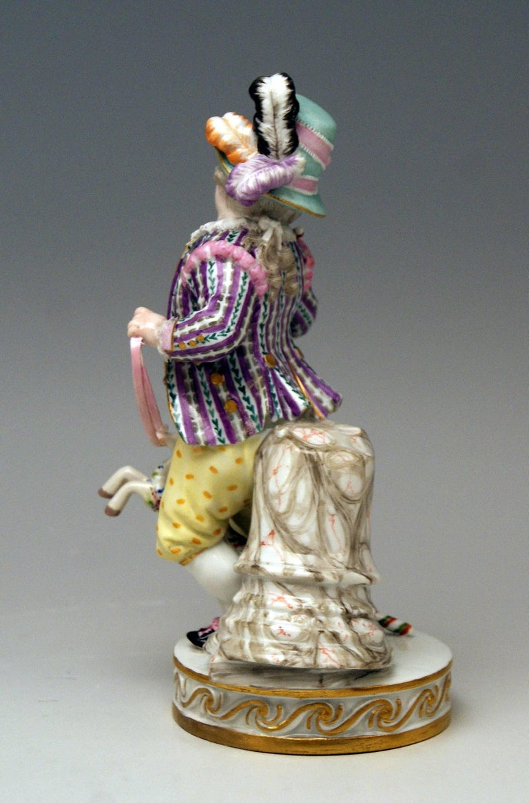 Painted Meissen Boy Riding on Hobbyhorse by Christian Juechtzer Model E 94, circa 1860 For Sale