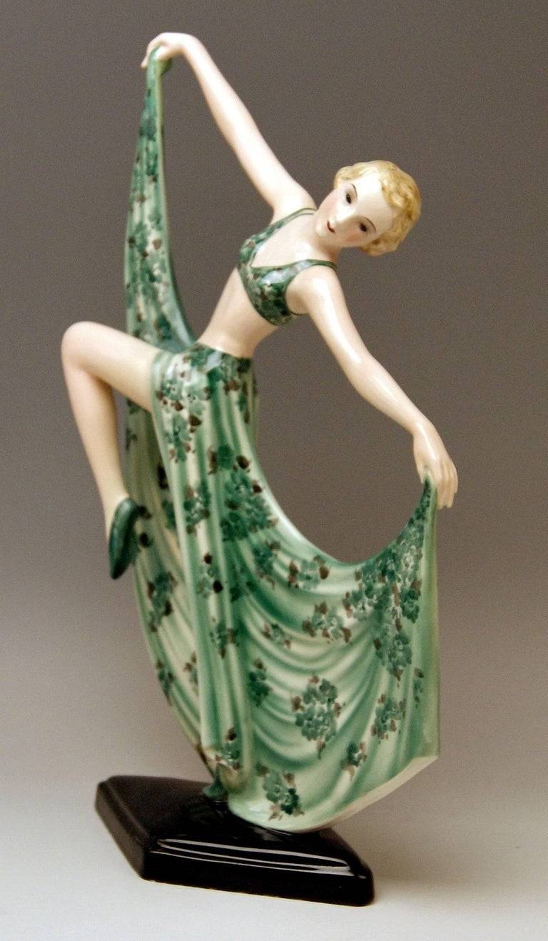 Semi-nude Art Deco lady dancer seizing corners of her skirt. Model 7053  Size:  height 15.2 inches (38.0 cm) width 9.055 inches (23.0 cm) depth 4.33 inches (11.0 cm)  Made by: Goldscheider Vienna/ manufactured circa 1936/37 Designed