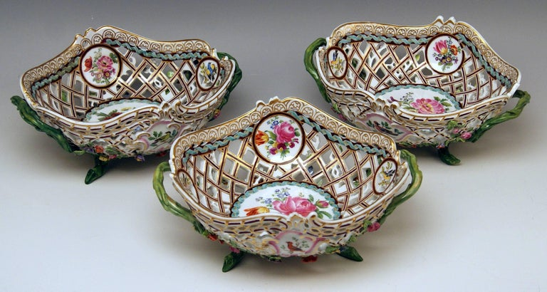 Meissen set of three oval reticulated basket bowls with flowers