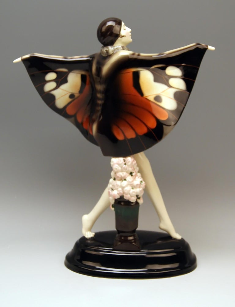 Goldscheider Vienna gorgeous dancingy lady figurine:  the captured bird turning towards left side.  Designed by Josef LORENZL  (1892 - 1950)  /  one of the most important designers having been active for Goldscheider manufactory in period of 1920 -
