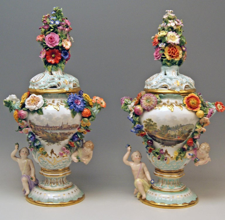 Meissen gorgeous quite rare items: A Pair of Potpourri Lidded Vases with abundantly sculptured decorations as well as with stunning topographical pictures and nicest flower paintings.  Manufactory: Meissen Hallmarked:  Blue Meissen Sword Mark