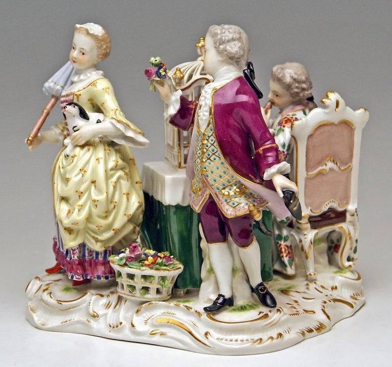 Meissen gorgeous group of figurines: Children clad in most elegant Rococo garments gathering around a birdcage. - The details are stunningly sculptured = finest modeling. Manufactory: Meissen Dating: made circa 1870 Hallmarked: Meissen Mark with