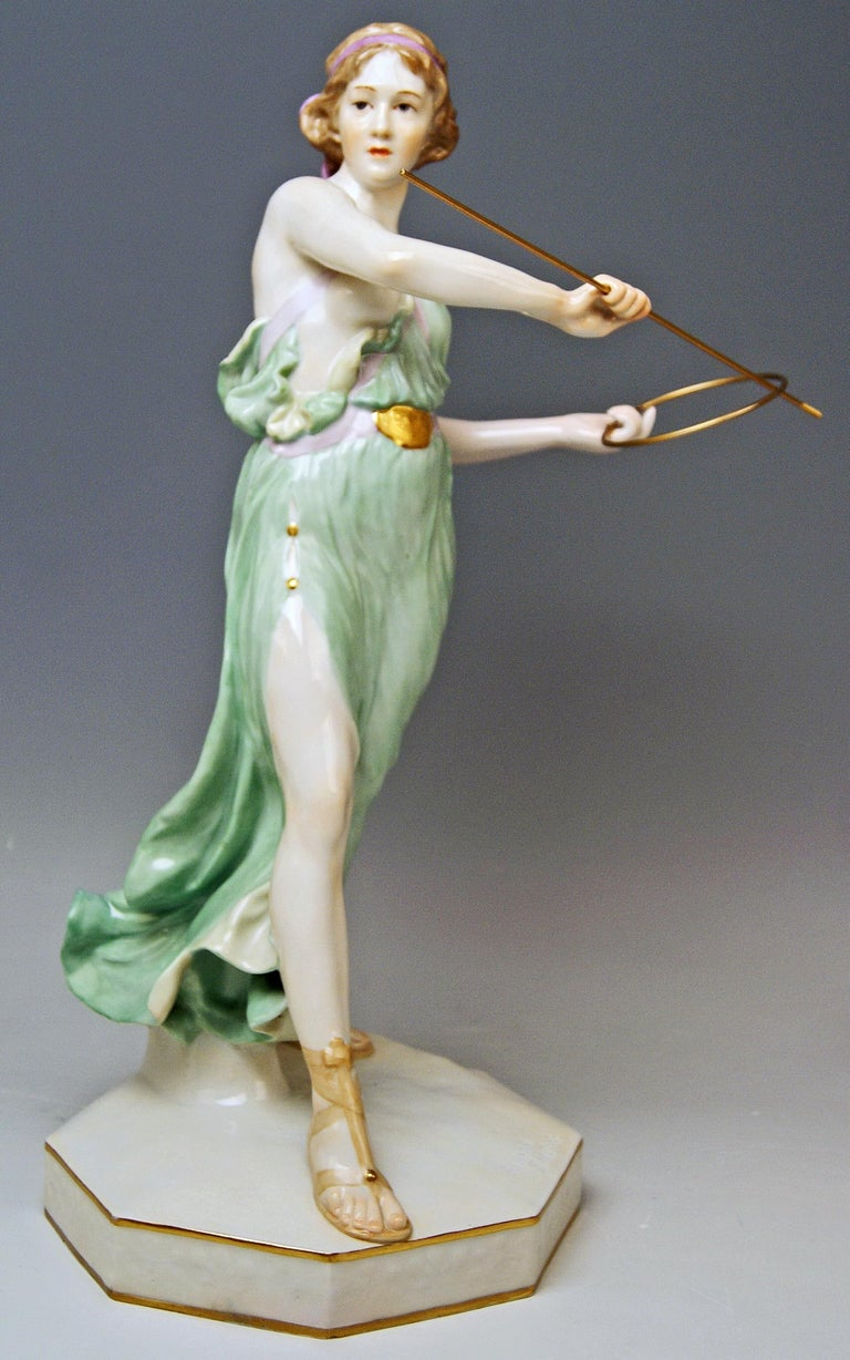 Meissen gorgeous figurine: girl throwing hoop The details are stunningly scupltured = finest modelling  Manufactory: Meissen  Dating: made circa 1935 Hallmarked: Meissen Mark of second quarter of 20th century (circa 1935) First quality model