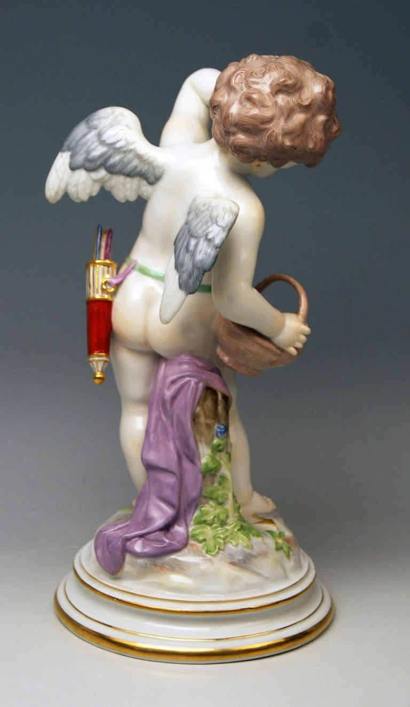 German Meissen Tall Cupid Figurine with Basket M Series 113 Heinrich Schwabe Made 1910 For Sale