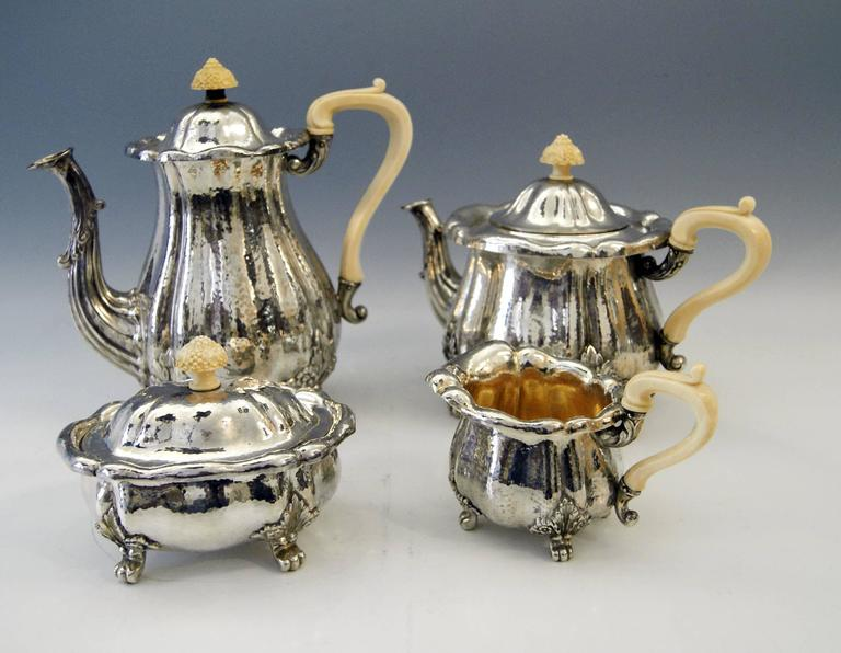 Silver stunning coffee / tea set in Baroque Style, Germany. Manufactured by J.D. Schleissner & Sons (Hanau), made circa 1890.   This set consists of various parts: Coffee potheight: 9.64 inches (24.5 cm). Tea potheight: 7.28 inches (18.5