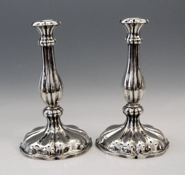 Austrian excellent Biedermeier silver pair of candlesticks, made 1855.  Very interesting Viennese silver pair of candlesticks of excellent manufacturing quality as well as of elegant appearance. These candlesticks were made during Viennese late