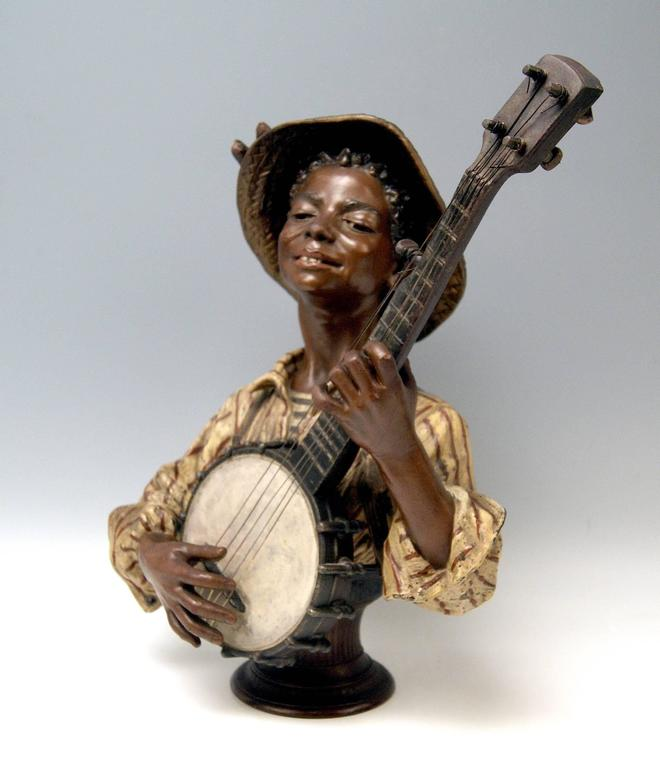 Goldscheider Friedrich bust (made of metal alloy  / painted): Black boy playing banjo (=  an american instrument). Made by Goldscheider French Manufactory in Paris: Founded in year 1892 by Friedrich Goldscheider (1845-1897) / the manufactory was