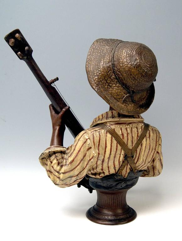 Painted Goldscheider Friedrich Metal Alloy Paris France Boy Playing Banjo, circa 1895 For Sale