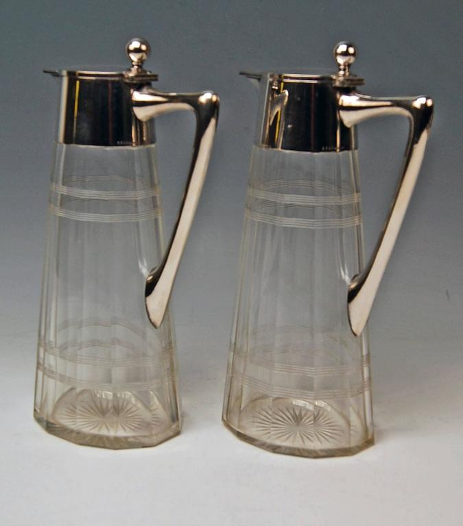 A pair ofArt Nouveau glass decanters (Carafes) with silver mountings. Hallmarked: Mark WTB:Germany/Schwaebisch Gmuend, manufactory Wilhelm Binder, number 8329. Silver 800. German official silver stamp: Crescent with moon.  Made, circa