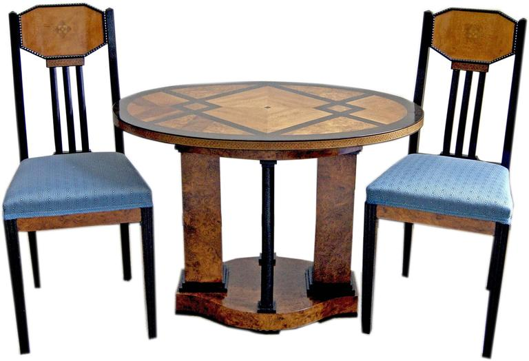 Gorgeous Art Nouveau table with two chairs of finest manufacturing quality.