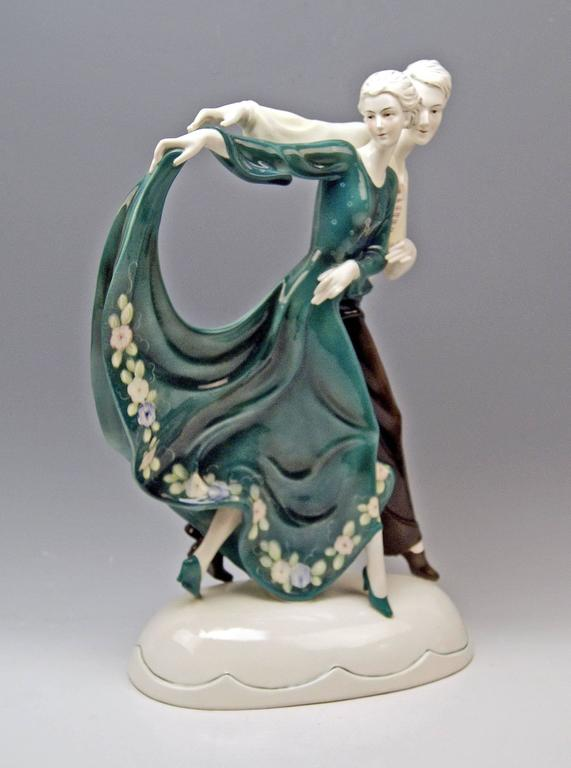 Stunning Art Deco tall dancing couple, manufactured in goldscheider style.  Model created before 1930 or made circa 1930.  Katzhu(e)tte (= Cat's House / in German: Katzhütte) / Hertwig & Co. porcelain manufactory.  Hallmarked: Katzhutte green