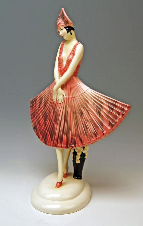 Goldscheider Vienna lady dancer wearing beautiful as well as rarely fan-shaped dress.