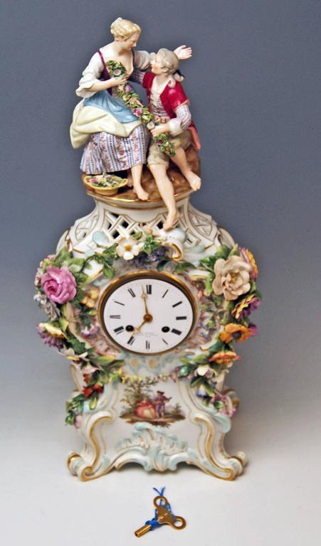 Meissen Gorgeous mantel / table clock abundantly decorated with sculptured figurines and flowers.