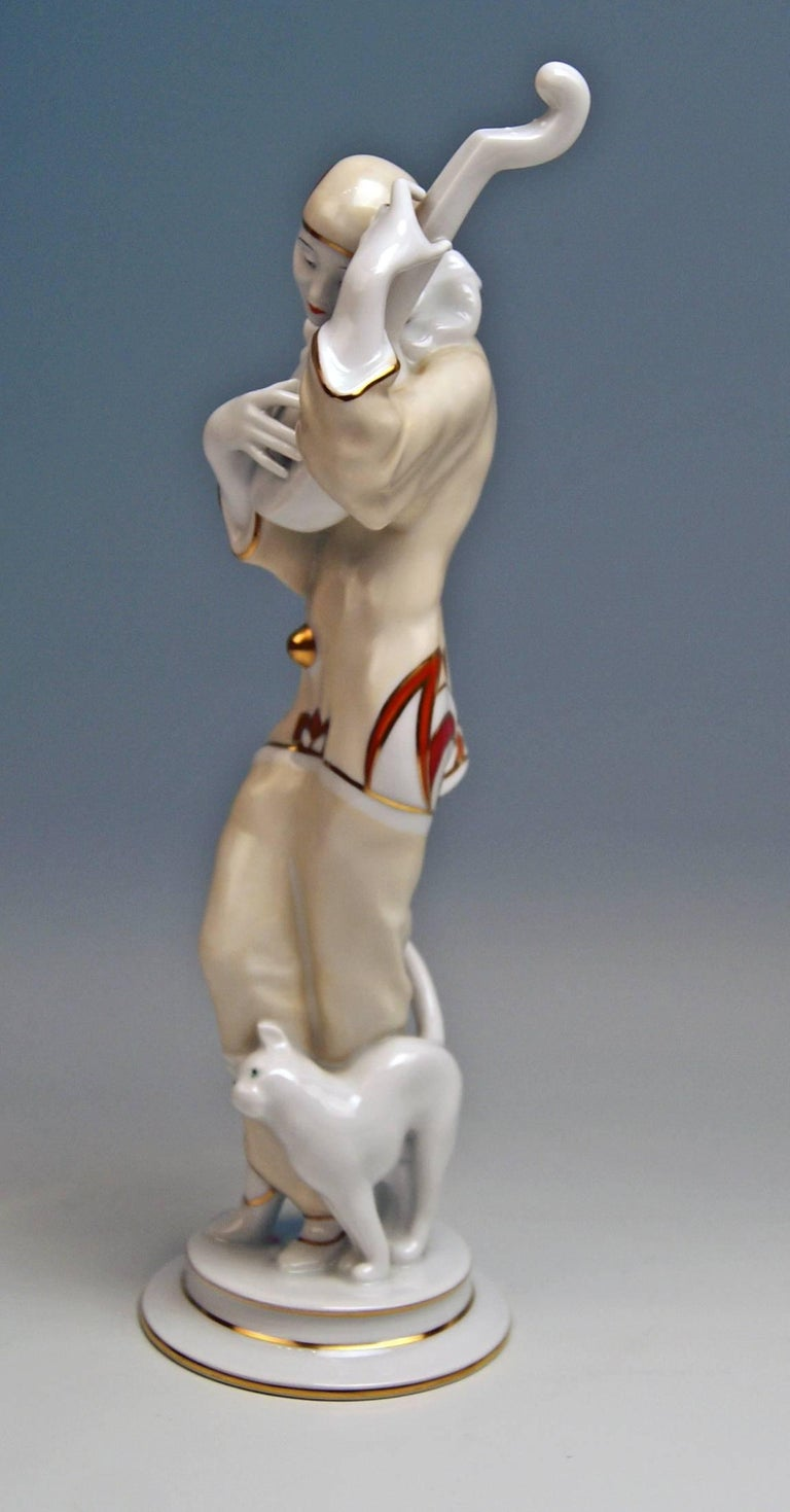 Rosenthal rarest Art Deco figurine of a Pierrot: A gorgeous rarest Pierrot figurine - called 'Ash Wednesday' - wearing a Pierrot's costume (ruff, cap, a loose-fit shirt and trousers) plays the lute / a lovely cat nuzzles up against Pierrot's legs.