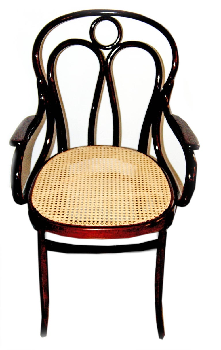Jacob and Josef Kohn bentwood armchair (Model 36) Made in Vienna / Austria, Art Nouveau period. beechwood  mahogany stained  seat is covered with wickerwork (restored) made, circa 1905  Bibliography: J.& J. Kohn Catalogues 1904 & 1907