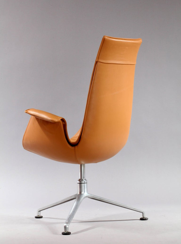 Two Tulip chairs, model FK 6725. Fiberglass shell with patinated cognac leather upholstery, polished aluminium tripod base. Production Kill International, 1966, Germany Measures: Height 41 inch (105cm), Seat height 17 inch (44 cm), Width 24 inch