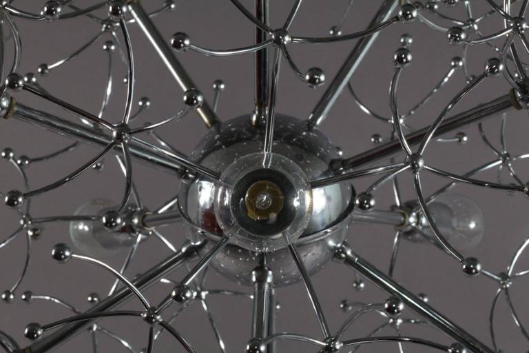 "A Sciolari chrome Sputnik chandelier with 11 light sockets. Diameter of the fixture is 23"". Total height to the top of the canopy is approximately 41"".