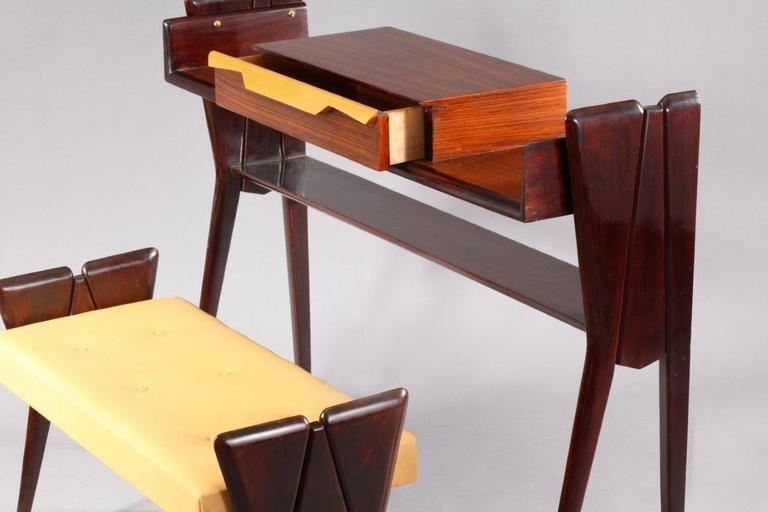 Console table with integrated bench, attributed Ico Parisi, Italy, 1950. dark walnut, two colored drawer. Bench with brown leather.