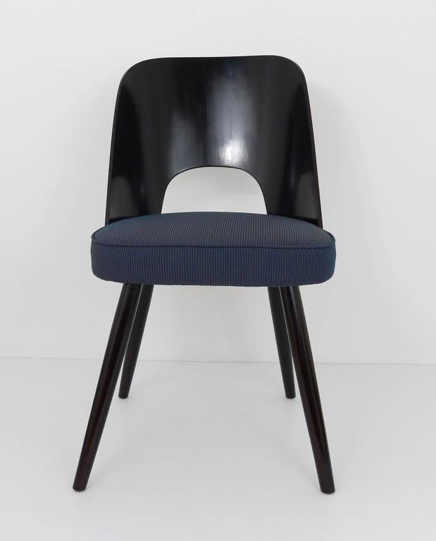A set of six modernist dining chairs, designed by Oswald Haerdtl, executed in the 1950s by Ton, Czechoslovakia. Made of dark brown / near to black wood. In excellent condition, gently restored and reupholstered with exclusive fabric by Maharam NY.