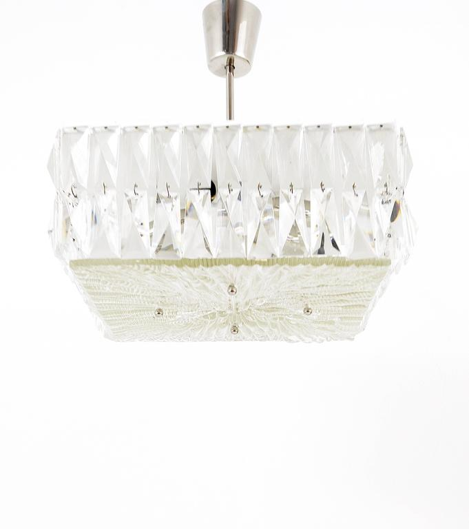 A square Mid-Century pendant lamp from the 1960s, executed by Bakalowits, Austria. A beautiful piece, white and nickel-plated metal hardware surrounded by two rows of square faceted crystals, it has a diffuser made of textured glass. This chandelier
