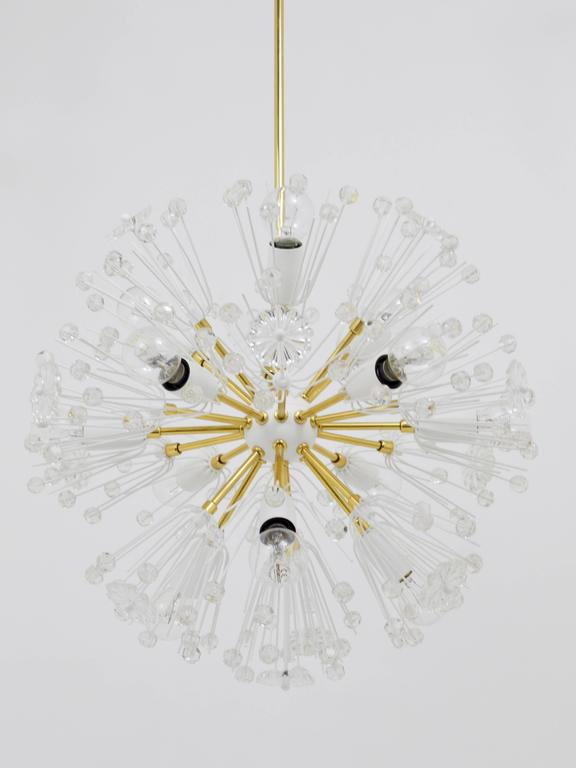 A very beautiful Mid-Century sputnik chandelier, designed by Emil Stejnar, executed by Rupert Nikoll Vienna in the 1950s. An early model with white ball in the centre and tulip canopy. Made of brass, fully covered with Austrian crystal balls and