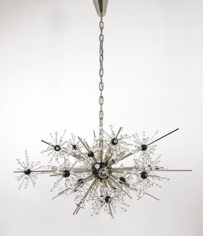 An iconic large Mid-Century Sputnik chandelier, designed by Hans Harald Rath in the 1966, executed by J. & L. Lobmeyr, Austria. Made of nickel-plated brass and Swarovski hand-cut crystals. The chandelier has seventeen-light sources, it has a