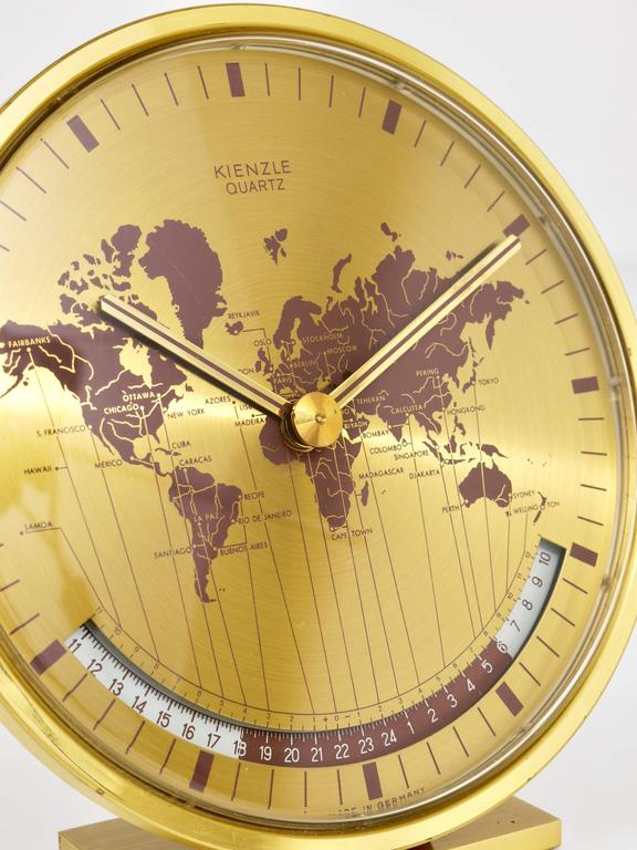 Mid century kienzle gmt world time zone brass table clock germany a beautiful modernist brass desk clock with a world map clocks face and world time zones gumiabroncs Image collections
