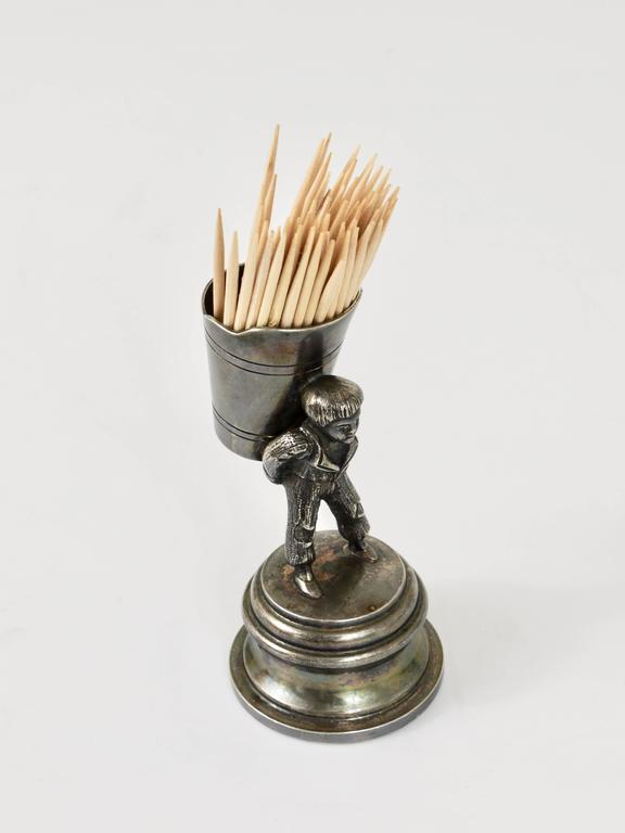 A beautiful silver plated toothpick stand from the 1920s, displaying a boy at vintage in the wineyards. A very charming piece in excellent condition.