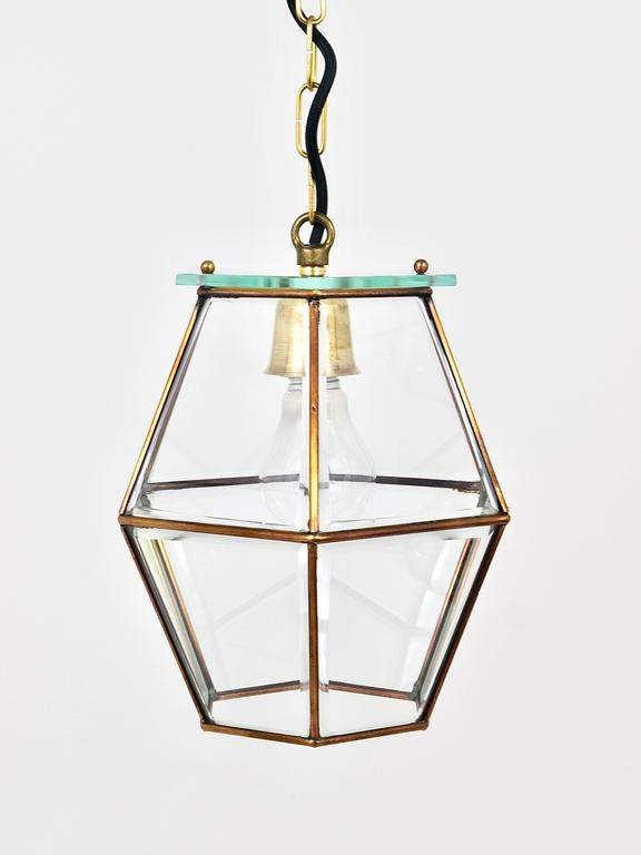 A beautiful handmade Austrian pendant light, dated circa 1900 in the manner of Adolf Loos. Made of brass and facetted glass. In good condition with patina on the brass. A unique light.