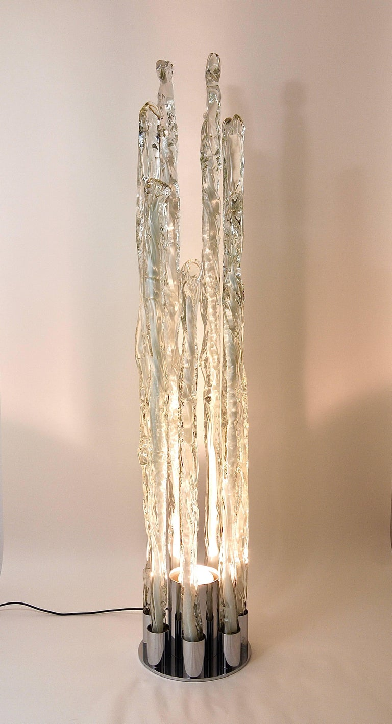 An impressive and huge floor lamp from the 1960s, designed by Carlo Nason. Made of Murano glass, executed by Mazzega Italy. Consists of a round chrome-plated metal base and seven handblown, clear and white melting glass sticks. A unique lamp in very